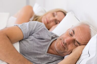 Senior couple in bed getting the sleep they need to dodge heart failure risk
