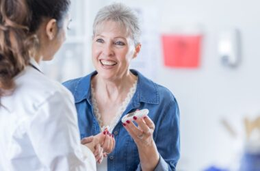 Senior woman with doctor checks blood sugar and is happy with results
