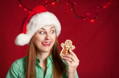Woman about to devour gingerbread man needs blood sugar help