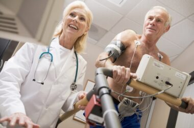 Doctor monitoring the heart rate recovery of a patient with a treadmill test