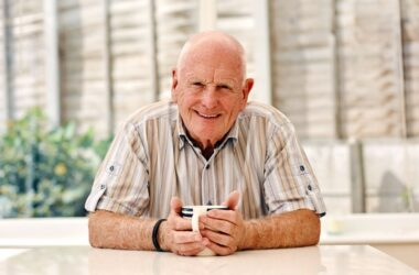 Happy senior man fighting prostate cancer with a cup of coffee