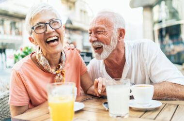 Mature couple laughing at breakfast table