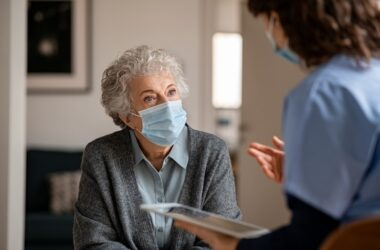 Senior woman in a mask visits a doctor during the pandemic