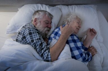 Senior couple in bed fighting dementia by getting enough sleep