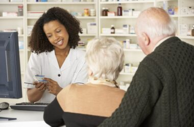 Pharmacist doing a medication review with senior couple to check for a bad med mix for dementia