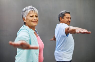 Senior couple fighting Alzheimer's decline with some stretching exercises