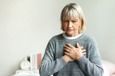 Senior woman with chest pain is suffering from a heart attack
