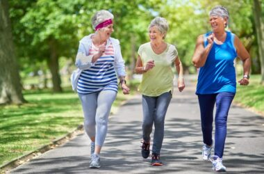 Three happy seniors fighting aging by staying active in the park