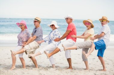 Youthful older couples defy aging as they dance on beach