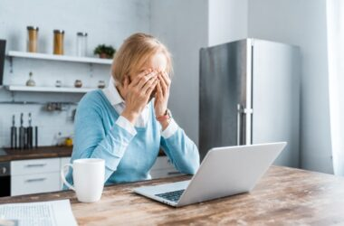 Stressed senior woman unhappy with aging skin on video call