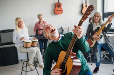 Group of seniors playing musical instruments to fight dementia
