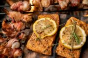 Low mercury bacon wrapped shrimp and cedar plank salmon on a charcoal grill