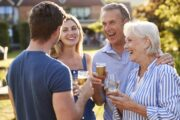 Senior and younger couple enjoying a heart healthy drink with alcohol