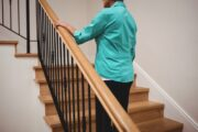 Senior woman walking up stairs at home for her heart health