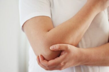 Woman with elbow discomfort starts to feel relief with Cannathol