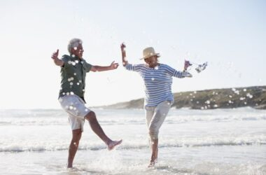 Fit and healthy senior couple splashing in ocean fight aging and take Senecell