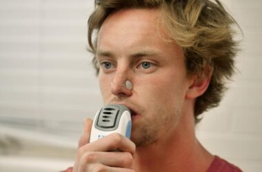 Man using an Inspiratory Muscle Strength Training device to lower blood pressure