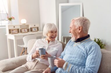 Smiling senior couple drinking atrial fibrillation risk and stroke reducing coffee