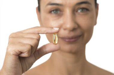 Woman about to take an omega-3 fish oil capsule to fight breast cancer risk