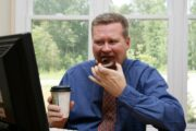 Mature man eats coffee and doughnut with damaging fructose
