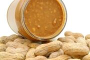 Peanut butter in a jar sitting on peanuts to illustrate cancer spread connection