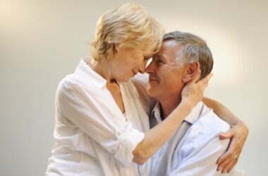 Sexy senior couple happy with EternaMale results in the bedroom