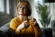 Smiling senior sips green tea for a memory boost