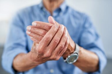 Close up focus on hands in pain triggered by weather changes
