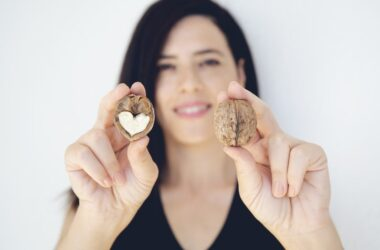 Close up of cholesterol taming walnut half with heart shaped core