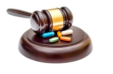 Gavel with pills illustrates FDA threat to resveratrol and other natural supplements