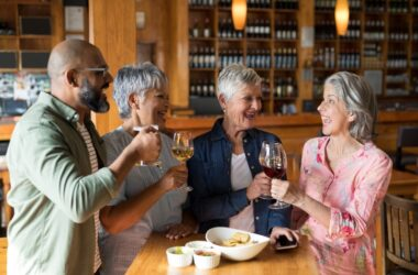 Happy friends having wine to reduce high blood pressure risk