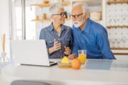Senior couple reading up on new vitamin C recommendations