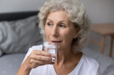 Senior woman drinks water to reduce heart failure risk
