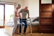 Senior man with age related muscle weakness uses walker