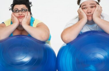 Overweight couple with exercise balls battles weight gain from diet soda